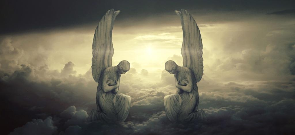 Two giant winged angels above clouds