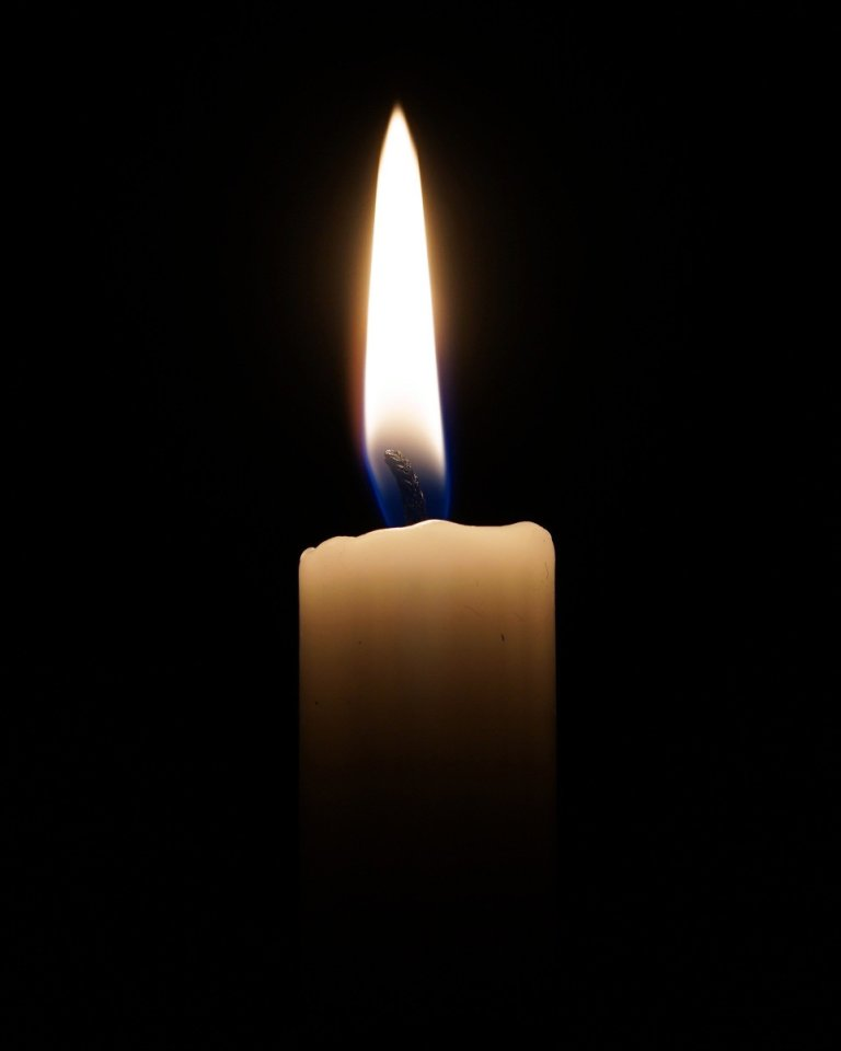 Top of a lit candle with a black background