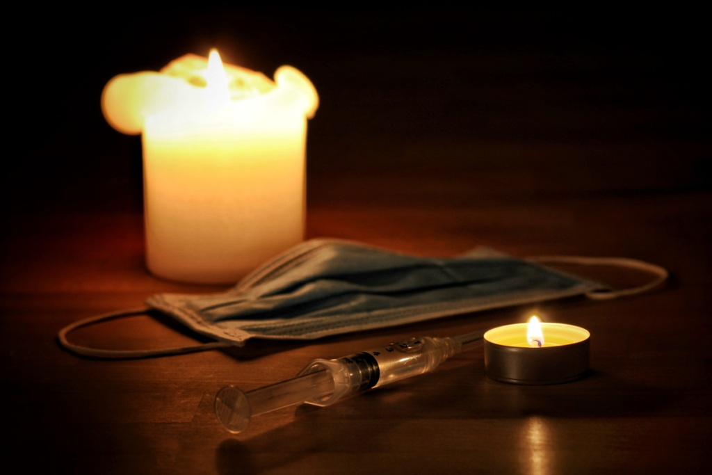 Euthanasia - candles, syringe, mask on table
