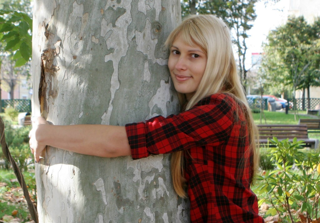 Woman Hugs Tree