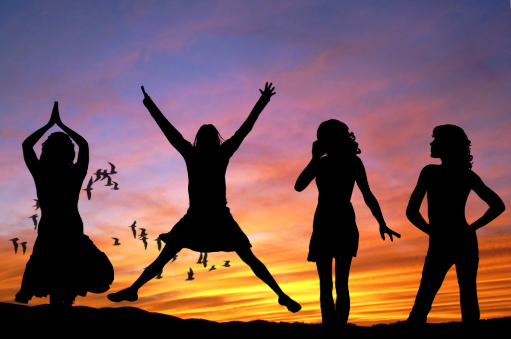 Woman jumping for joy with women