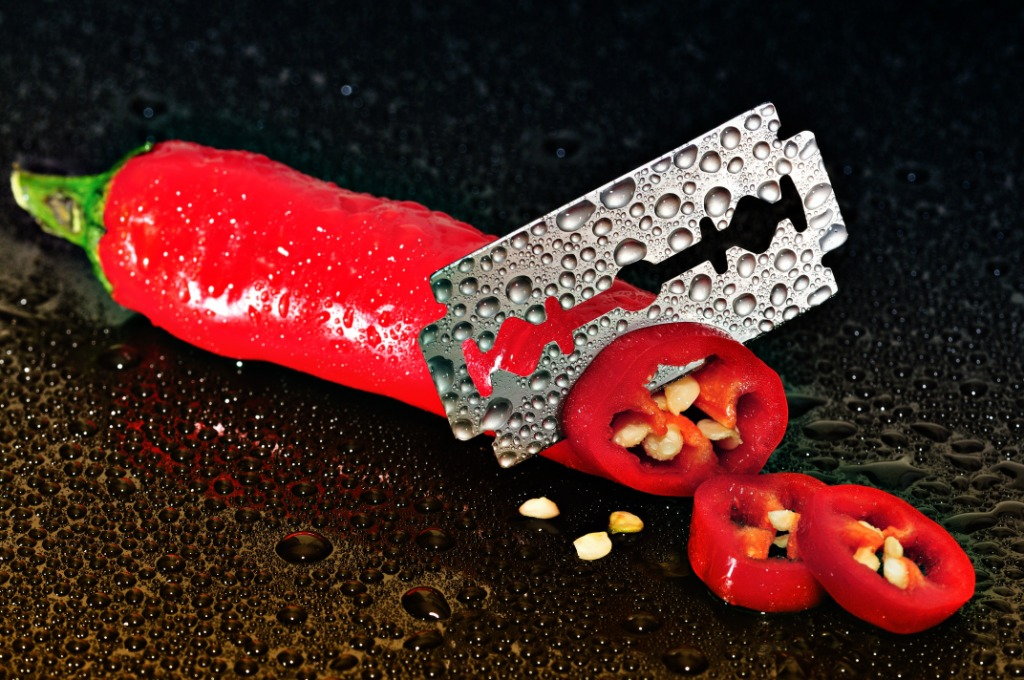 Red chilli being cut up by razor