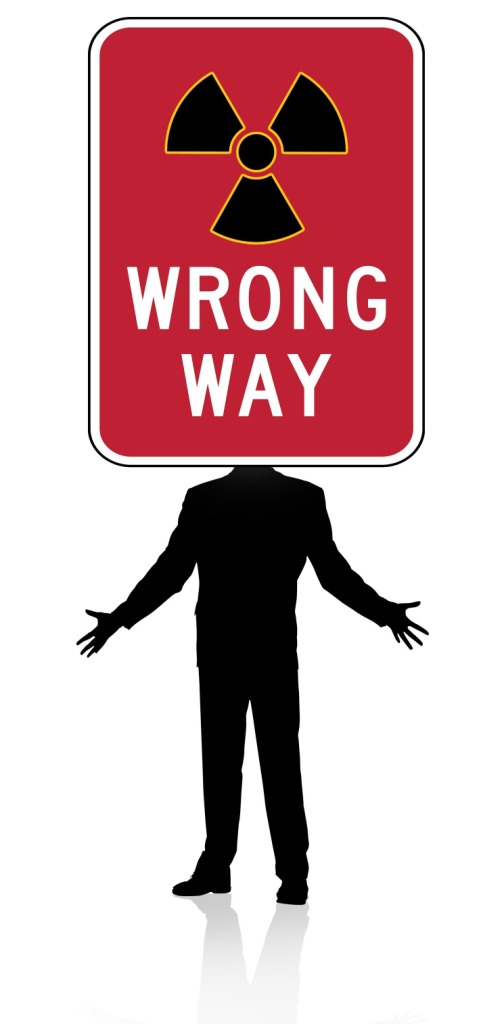 Graphic of silhouette man, arms outstretched to side, sign saying 'Wrong Way' covers his head